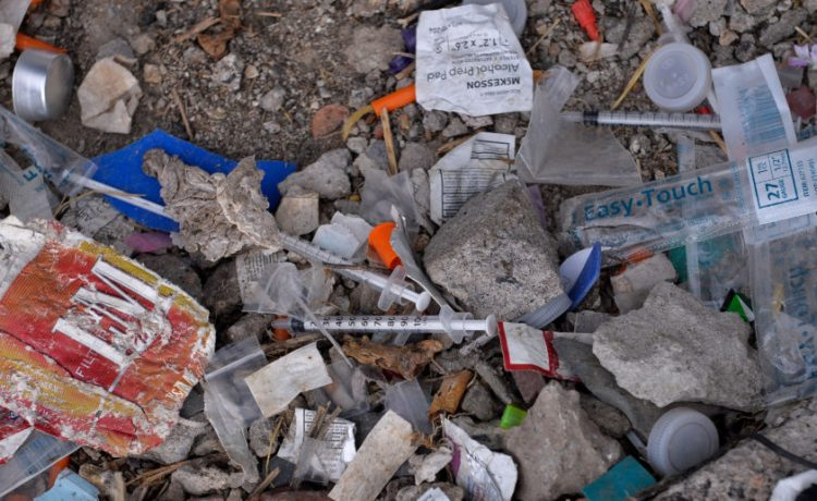 Needles used for shooting heroin and other opioids along with other paraphernalia litter the ground in a park in the Kensington section of Philadelphia, Pennsylvania, U.S. October 26, 2017. REUTERS/Charles Mostoller