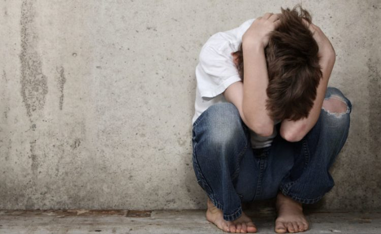 An abused kid (shutterstock/ Suzanne Tucker)