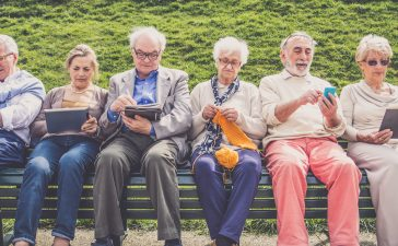 Old people in a park. (Shutterstock/oneinchpunch)