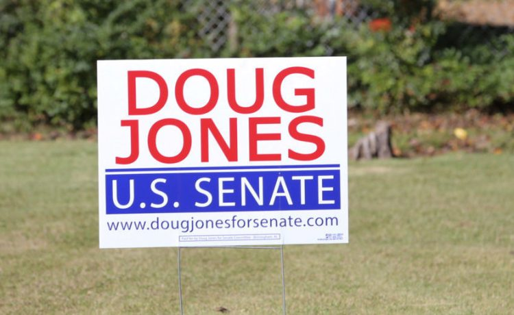 U.S. Senate Democratic candidate Doug Jones' election sign is posted around the Jefferson County, Alabama area prior to the upcoming special election against Republican candidate Judge Roy Moore in Hoover, Alabama, U.S. November 10, 2017. REUTERS/Marvin Gentry