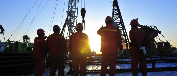 Workers on an oil rig. (Shutterstock)
