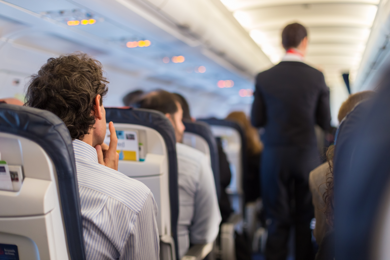 Passengers sit on a plane. Shutterstock image via user Matej Kastelic