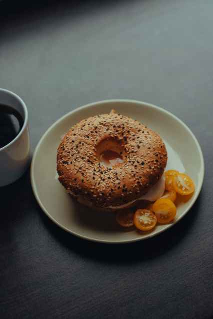 delicious breakfast bagel and black coffee