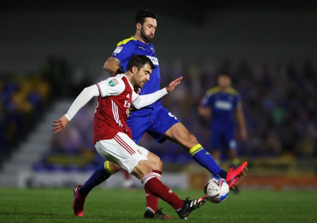 WIMBLEDON, ENGLAND: Sokratis Papastathopoulos of Arsenal is blocked by Ollie Palmer of AFC Wimbledon during the Papa John's Trophy Second Round match between AFC Wimbledon and Arsenal U21 at Plough Lane on December 08, 2020. (Photo by James Chance/Getty Images)