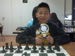 Luke Zhao won a trophy for beating Coach Torres.