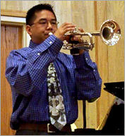 "Mr. Diaz is ""Houston's only chess and trumpet professional."""
