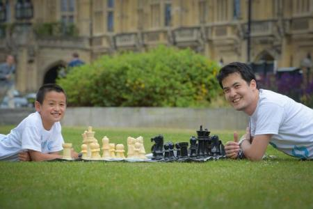 Kevin Pan hanging out with Grandmaster David Howell after Kevin defeated the GM in a simul!