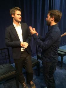 Magnus Carlsen talking with Bobby Fischer(Tobey Maguire.)