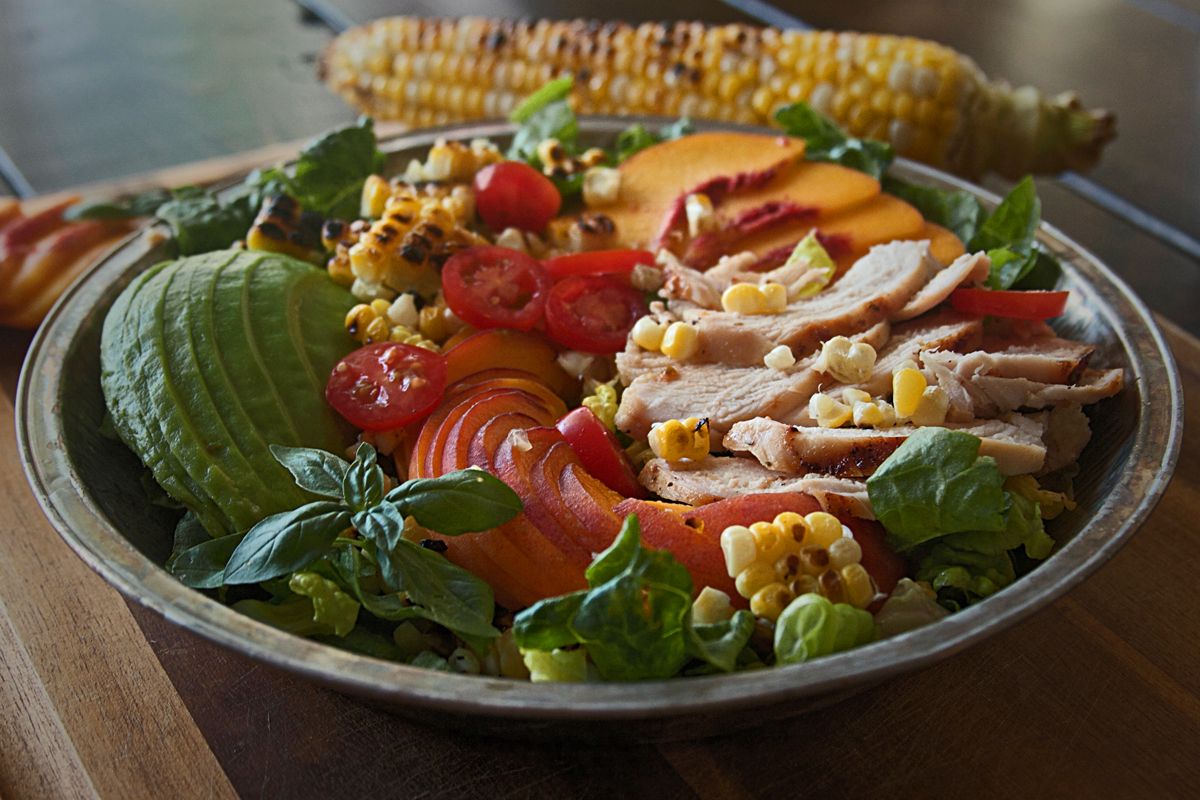Grilled Chicken and Peach Salad with Corn and Avocado