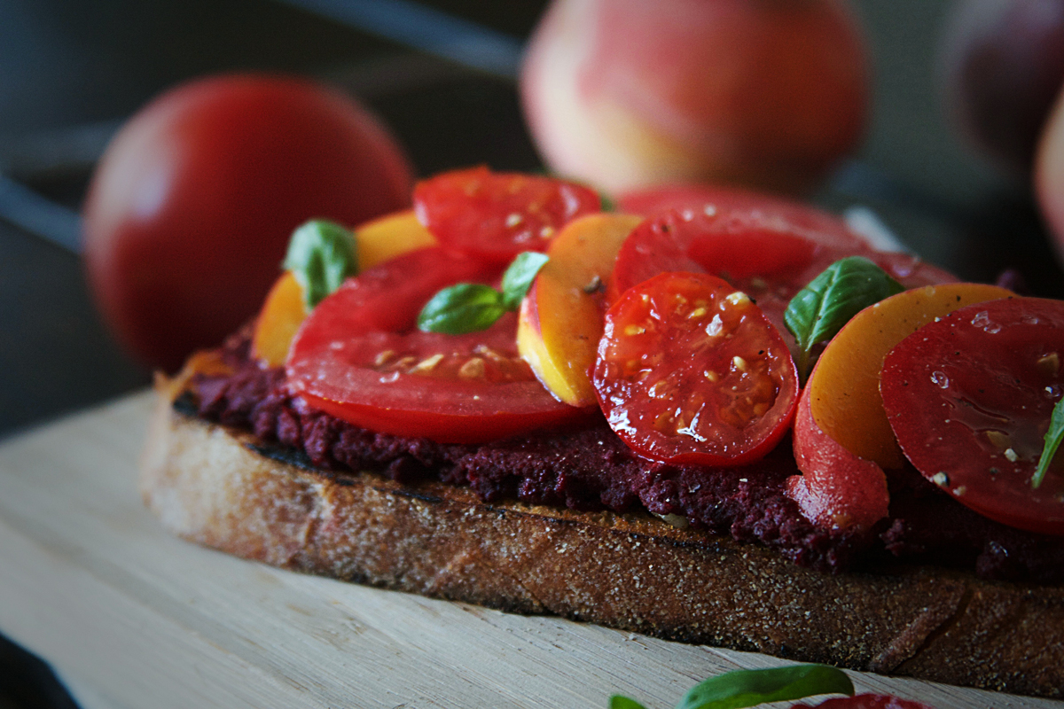 Roasted Beet Hummus Crostini with Peaches and Tomatoes
