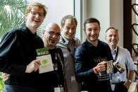 Grabbing an espresso between lectures. Pictured are several of the baristas from the event, including Christian Ullrich pictured second from the right, who is the 2014 World Latte Art Champion.
