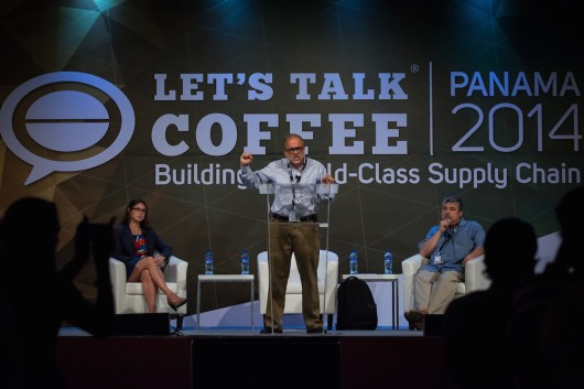 Carlos Brando, P&A International Marketing, speaks during the lecture 'Making Sense of Today's Coffee Market. Seated Ric Rhinehart SCAA and Leslie Josephs of the Wall Street Journal.