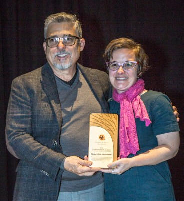 The SCA's Ric Rhinehart giving the plaque to Conservation International's Bambi Semroc.