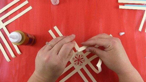 glue the ends of the paper snowflake together