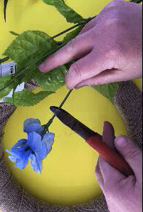 Cut the end of the artificial flowers to place on the spring farmhouse wreath