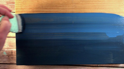 Blending two shades of blue paint to make an ombre sign