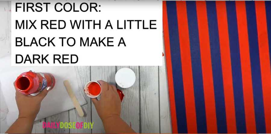 Mix the first color of paint. Add a little black to red to make a dark red color.