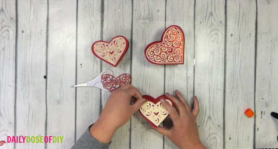 glue the filigree hearts to the top of the box