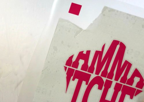 Using guides to layer adhesive vinyl