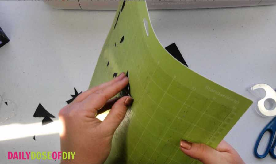 remove the paper scraps from your cricut cut mat