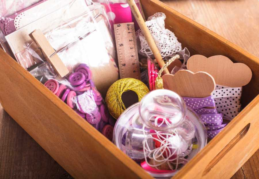Scrapbooking craft materials organized in a wooden box
