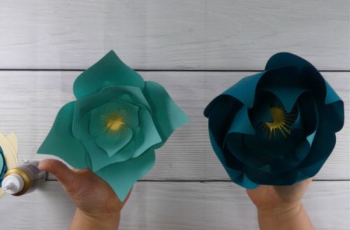 Paper flowers one with curled petals and one without curled petals