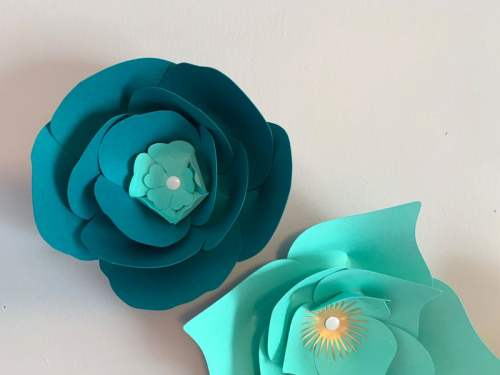 Use thumbtacks in the center of the flower to attach them to a wall to make a paper flower wall display