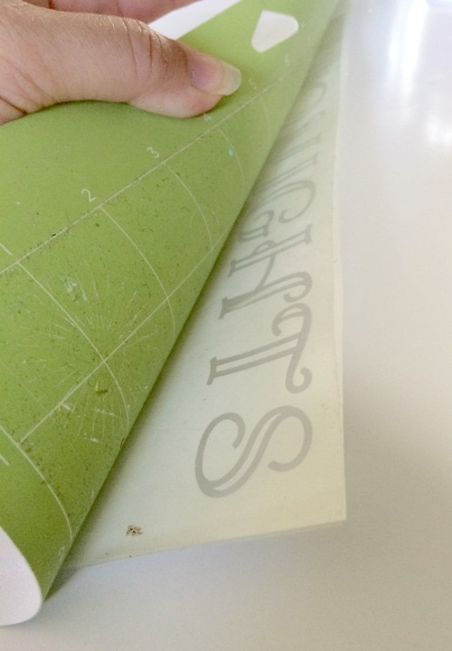 Flip your cricut mat over to remove your freezer paper stencil