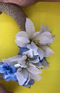 Adding flowers to your Spring Farmhouse Wreath.