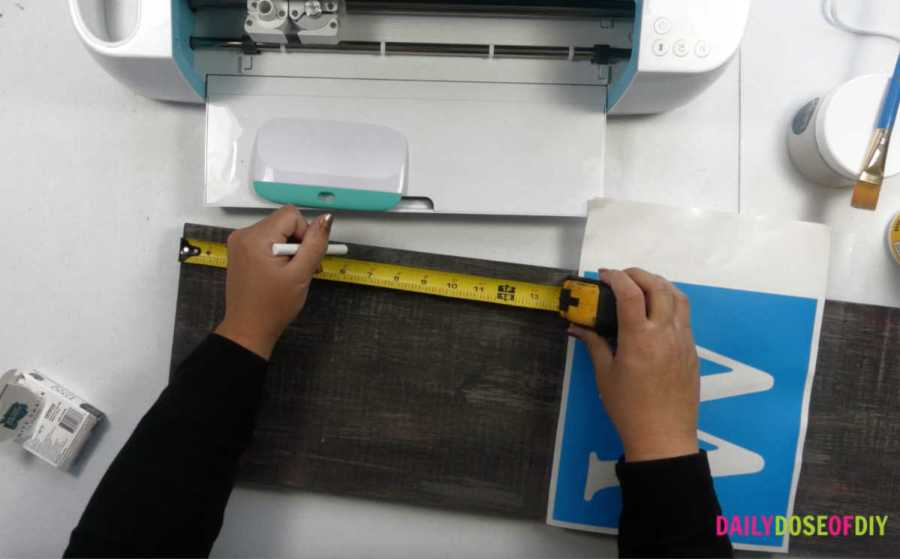 Measure 6 inches from the top to start your vertical welcome stencil
