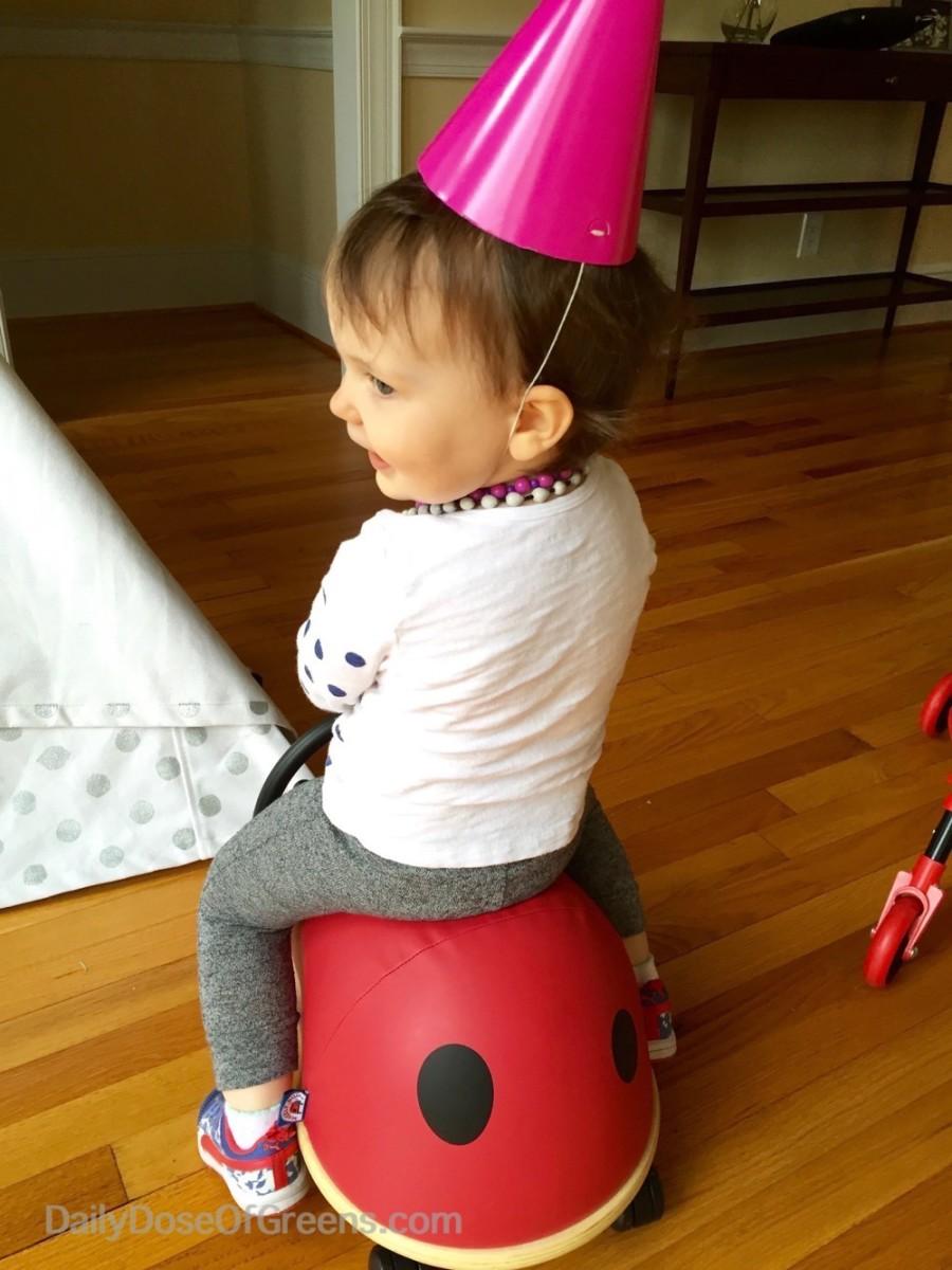Abby riding her ladybug