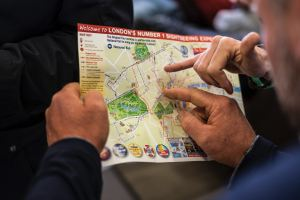 Tourists using a travel map