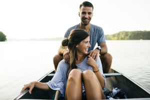 Happy couple sailing in a small boat