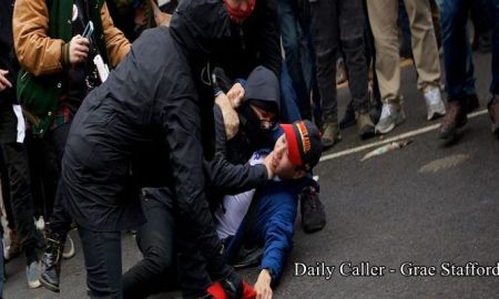 a-protester-chokes-a-trump-supporter-as-they-attempt-to-steal-his