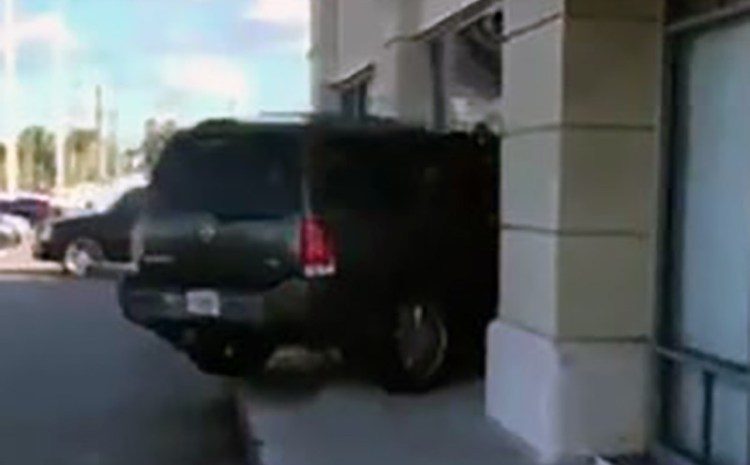 Woman Can't Get Screen Replaced On iPhone, Drives SUV Through T-Mobile Store [WATCH]