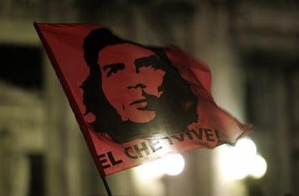 "A flag with an image of Argentine-born iconic revolutionary ""Che"" Guevara is waved in front of Argentina's Congress in Buenos Aires"