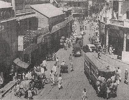 A tram snaking it's way throught the old chandni chowk market