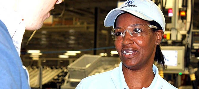 A worker at VW's Chattanooga plant answers questions from the author during a plant tour in 2011.