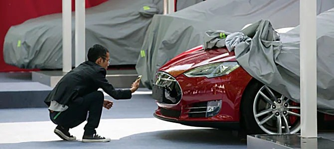 The industry zeroes in on the upstart Tesla.