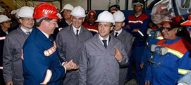 Macron points finger at Detroit, somewhere over his right shoulder