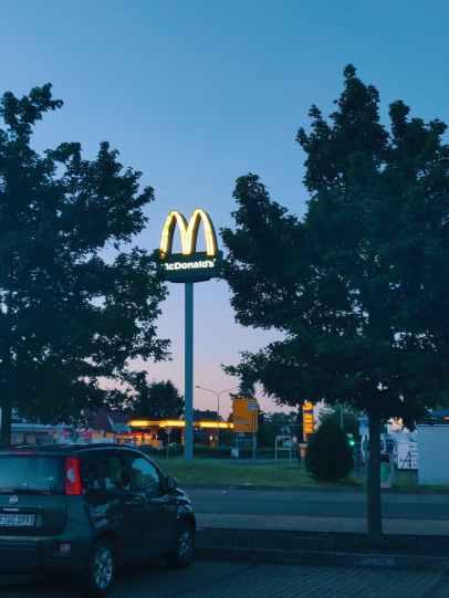 photo of car parked near mcdonald s