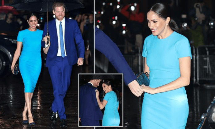 Meghan Markle wears a gorgeous blue Victoria Beckham dress for her stylish return to the UK