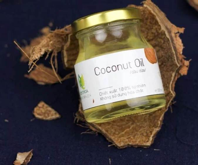 Picture shows a coconut oil jar on top of a coconut shell
