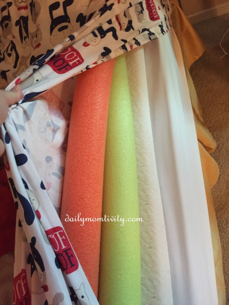 Use pool noodles to keep kids in place and they will not fall out of the bed!