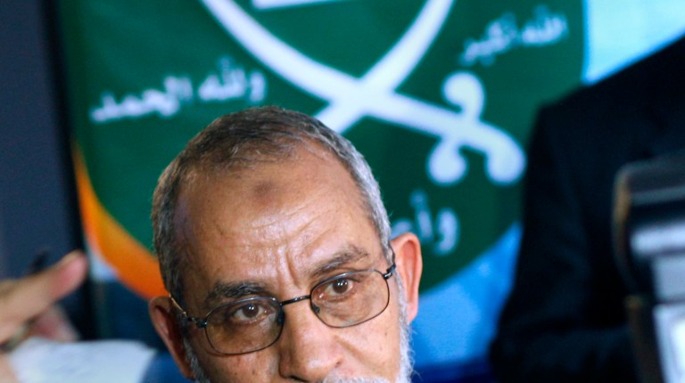 Egypt's Muslim Brotherhood Mohamed Badie looks on under the group's logo during his first press conference in Cairo, Egypt, Saturday, Jan. 16, 2010 (AP Photo/Amr Nabil)