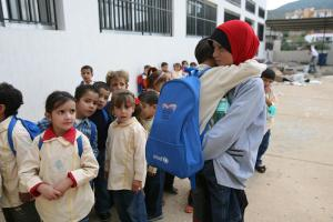 Children line up at a charity supported school in Cairo (File photo) AFP PHOTOS