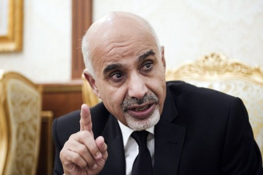 Libya's de facto head-of-state Mohammed Megaryef gestures during an interview with AFP on September 21. Megaryef said not all areas of the country have been liberated, in remarks one year since the death of dictator Moamer Kadhafi. (AFP Photo)
