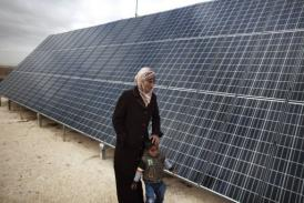 The ministry plans to use solar energy stations to produce 100 MW per year. (AFP PHOTO / Menahem Kahana)