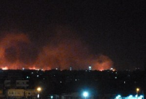 Fire rages at the state-owned Yarmouk military factory in southern Khartoum, Sudan. (AFP PHOTO)