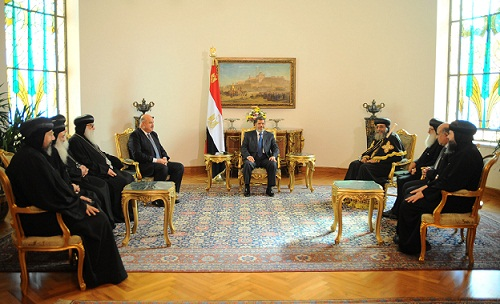 President Mohamed Morsy welcomed Pope Tawadros II and several bishops to the presidential palace. (Photo courtesy of the presidential office)